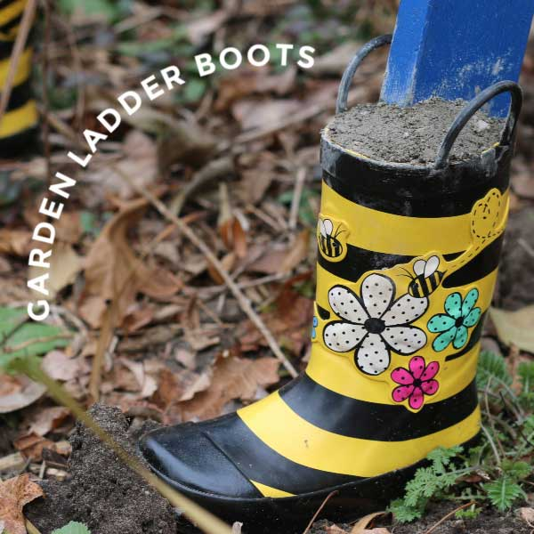 Rubber boots on base of garden ladder.