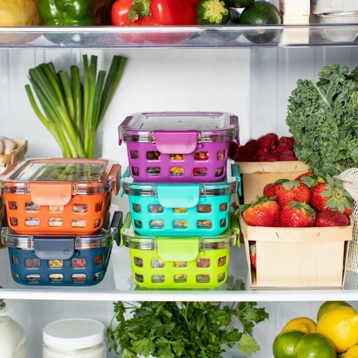 Fresh fruits and vegetables stored in a refrigerator.
