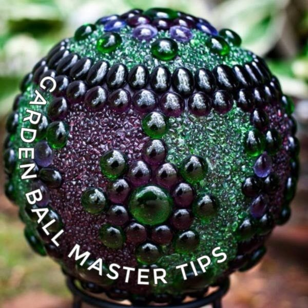 Purple and green decorative garden art ball.