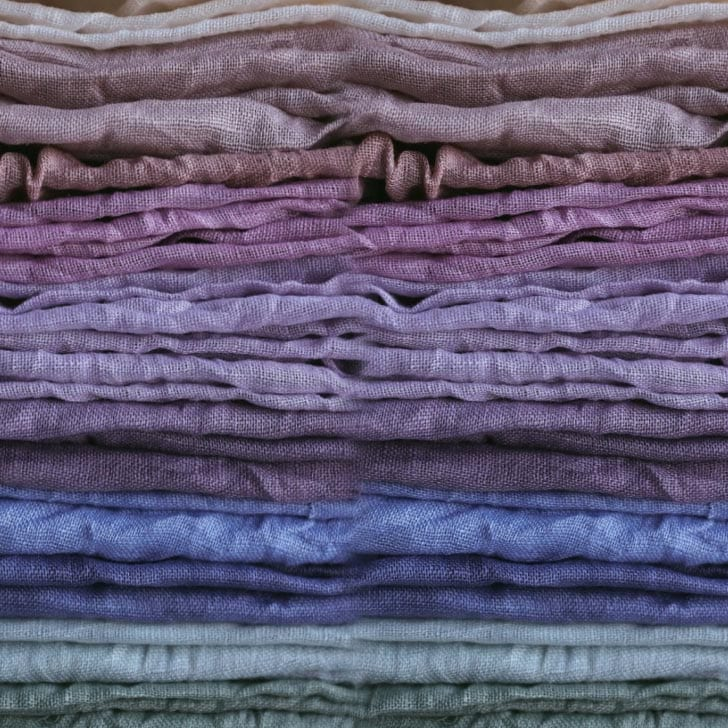 A pile of plant-dyed fabrics.