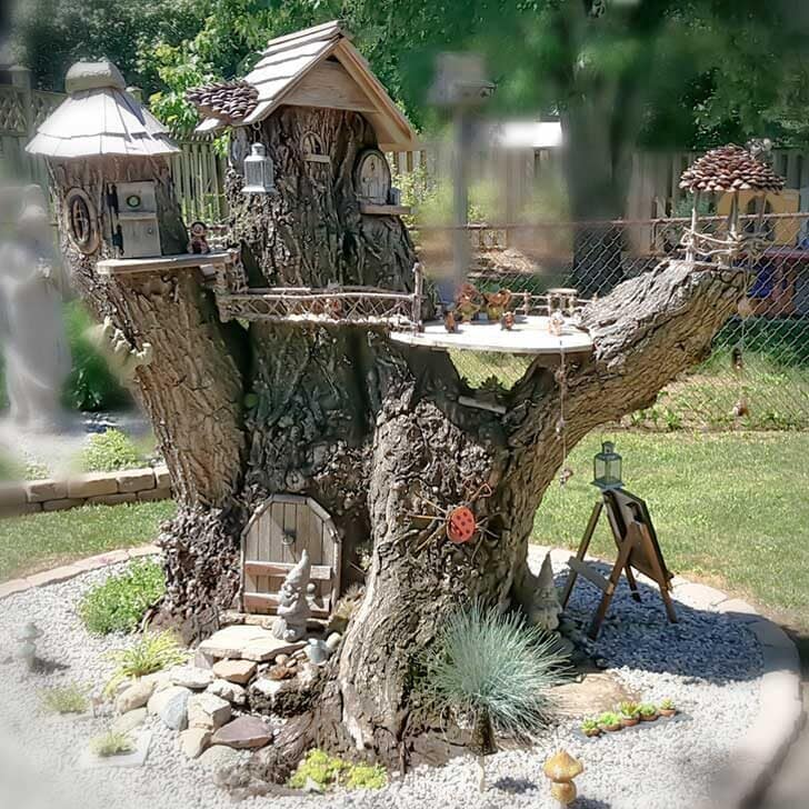 Tree stump fairy home in the garden.