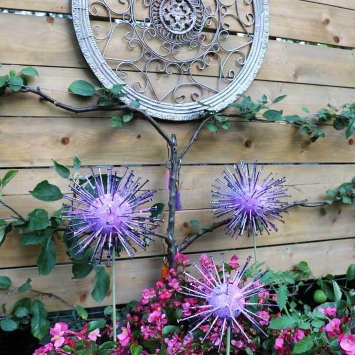Homemade allium garden art decorations in the garden.
