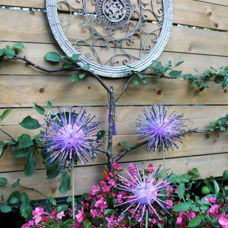 Homemade allium garden art decorations in the garden.