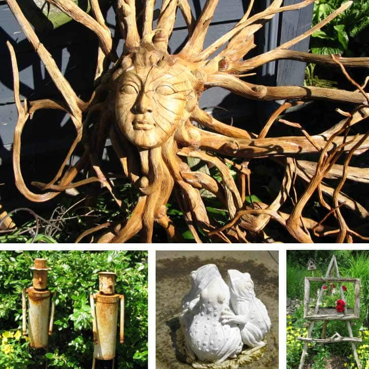 Quirky garden art including a hand-carved sun face made from wood.