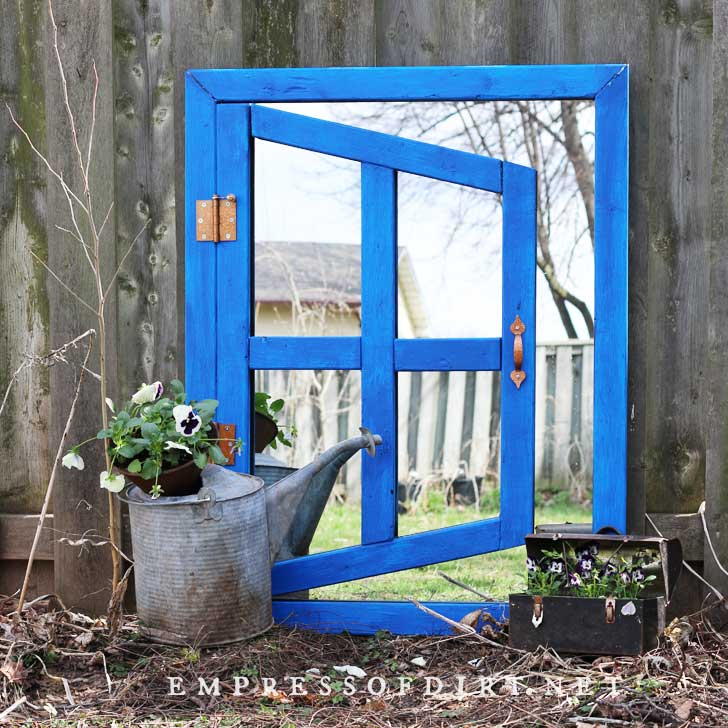 Optical illusion garden mirror painted blue.
