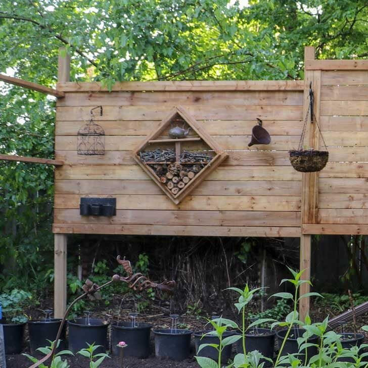 Freestanding wood privacy wall in garden.