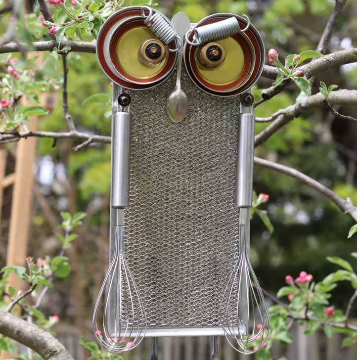 Garden art owl made from upcycled kitchen and hardware items.