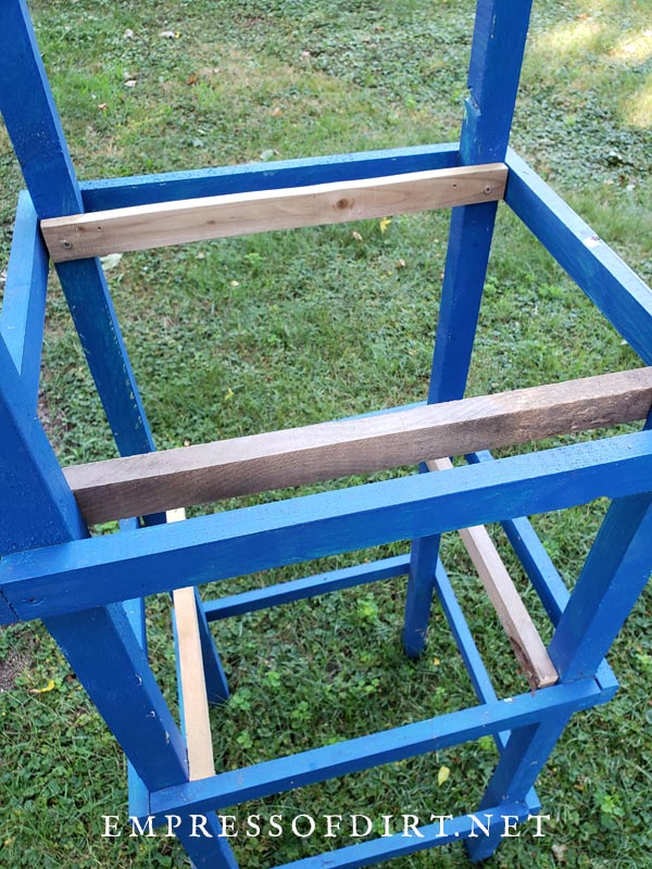 Inner support rails on wooden tomato cage.