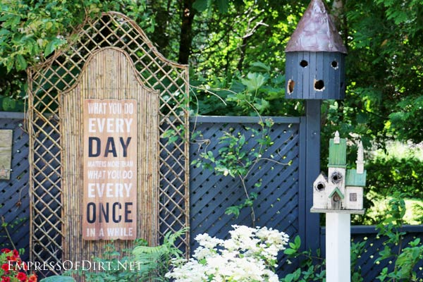 Garden sign with birdhouse.