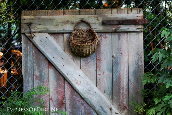 Rustic gate with old basket.